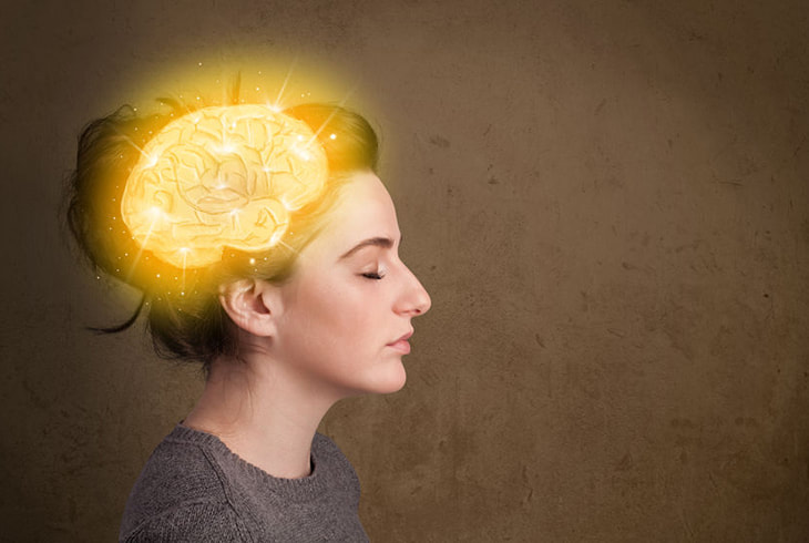 Woman with illuminated brain