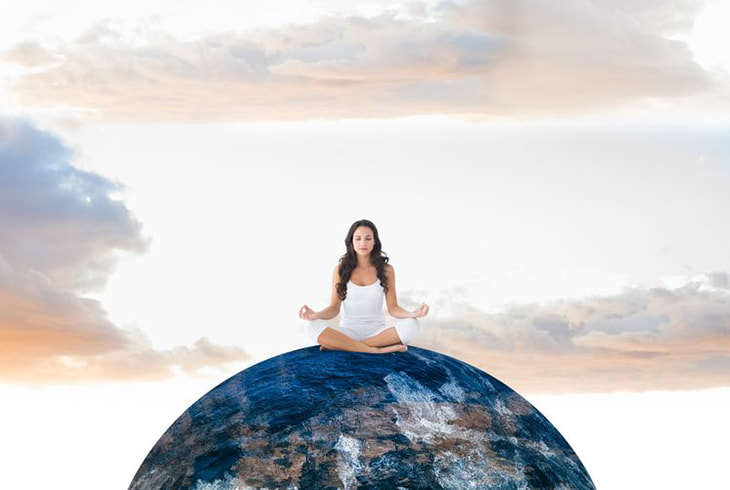 image: woman meditating on top of the world