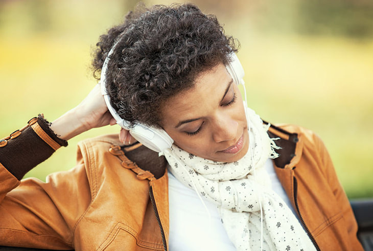 Woman listening a sad song
